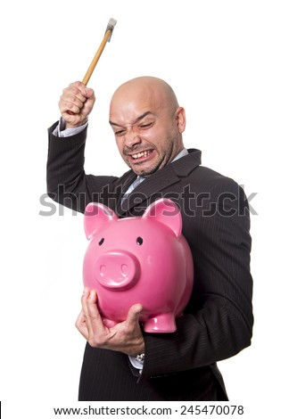 bald Hispanic businessman with hammer in his hand holding pink piggybank ready to break the piggy bank and take money and savings out isolated on white background - stock photo