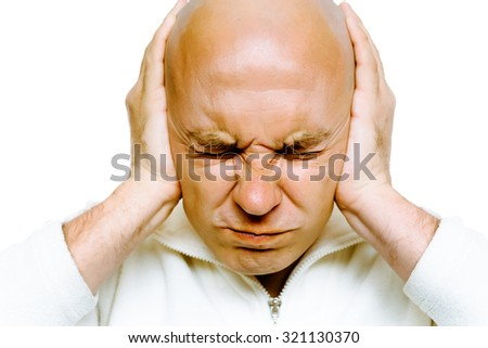 Bald man closed his eyes and covered his ears with his hands. Studio. isolated - stock photo