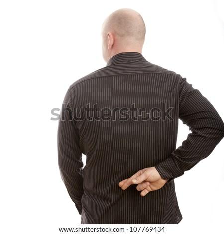 bald man cross finger on the back - stock photo