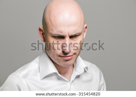 Bald man disappointed portrait