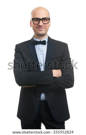 bald man in a suit and bow tie isolated on white - stock photo