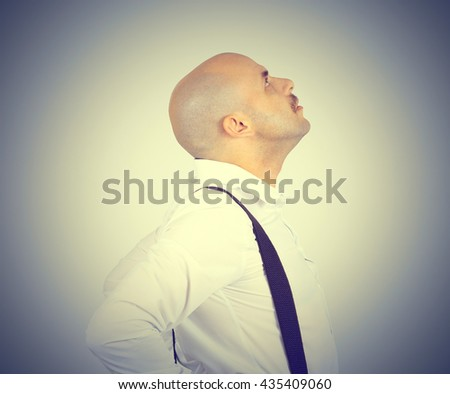 Bald man looking up. Side view. Thoughts, ideas. - stock photo