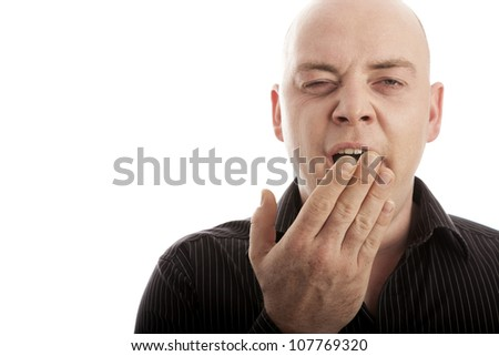bald man on white background is tired and yawn - stock photo