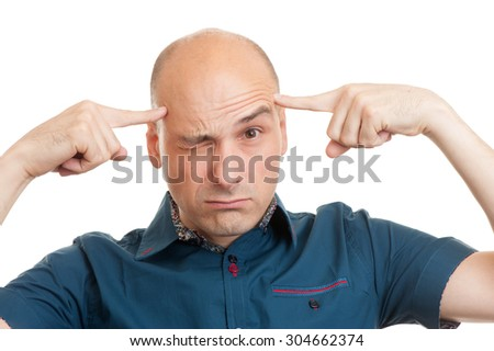 bald man thinks intensely on white background - stock photo