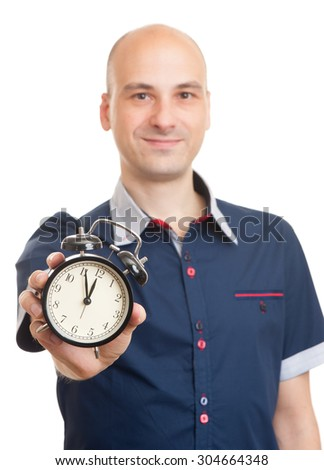 Bald man with an alarm clock isolated on a white background - stock photo