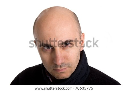 Bald man with angry expression.