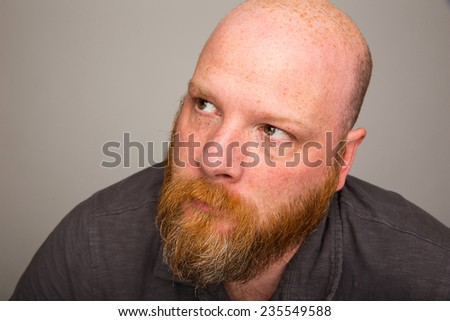bald man with beard looking up