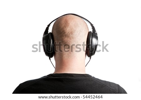 Bald man with headphones on white background - stock photo