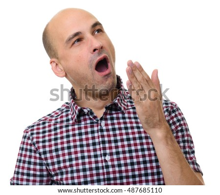 Bald man yawning isolated on a white background