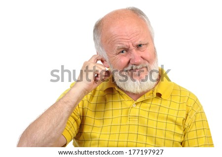 bald senior man picking his ear with index finger