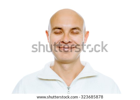 Bald smiling man with his eyes closed. Isolated on white. Studio - stock photo