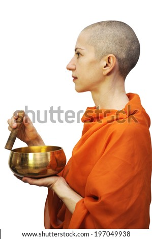 Bald woman in saffron robe with singing bowl, meditating. Isolated on white, clipping path included.