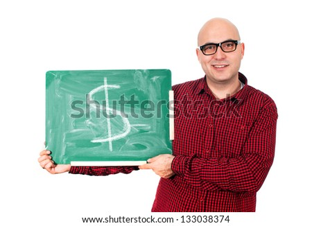 Bald young adult man with glasses holding a small green chalkboard with dollar sign.