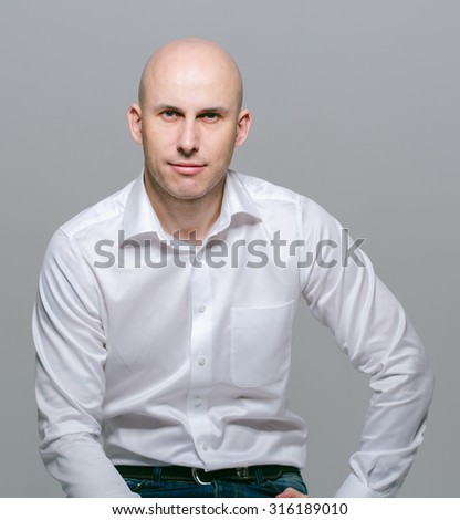 bald young man portrait - stock photo