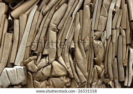 Bale of compressed carton tubes for recycling - stock photo