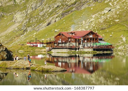BALEA LAKE RESORT, ROMANIA - AUGUST 24: Unidentified tourists enjoy Balea Lake chalet surroundings at 2,034 m altitude on August 24, 2011 in Balea Lake Resort, Fagaras Mountains, Romania.