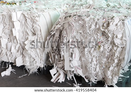 Bales of cardboard and box board with strapping wire ties - stock photo