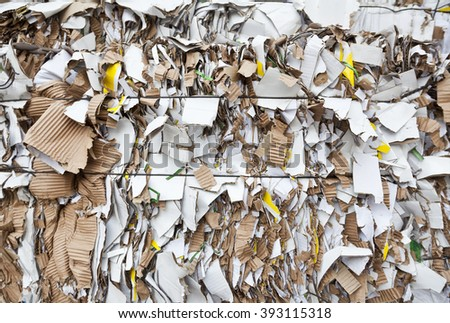 Bales of cardboard and box board with strapping wire ties in focus - stock photo