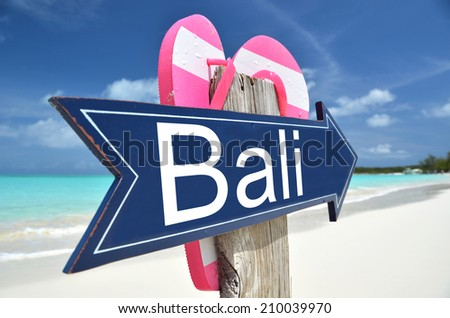Bali arrow on the beach - stock photo