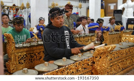 BALI - FEB 18: Unidentified musicians play in a gamelan orchestra on Feb 18, 2014 in Bali, Indonesia. Gamelan is a traditional music of Indonesia originating on the islands of Java and Bali.