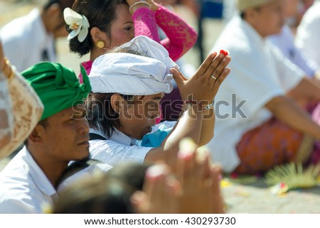 Bali Indonesia Apr 4, 2016 : Balinese people in traditional costume attending Meprani Ceremony at tample in Batur. Meprani is one of the Hindu ceremony in Bali Island Indonesia. - stock photo