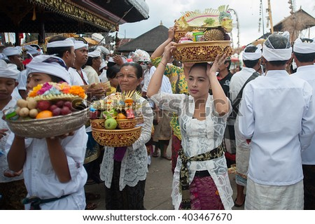 Bali Indonesia Apr 4, 2016 : Balinese woman carrying offering during Meprani Ceremony in Batur. Meprani is one of the Hindu ceremony in Bali Island Indonesia.