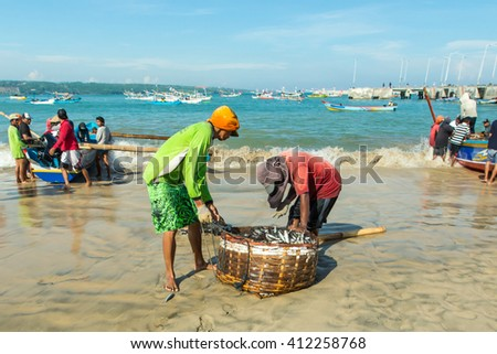Bali Indonesia Apr 5, 2016 : Daily activities at Jimbaran village pictured on Apr 5, 2016 in Bali Indonesia. Jimbaran village is among famous place to see fisherman life in Bali. - stock photo