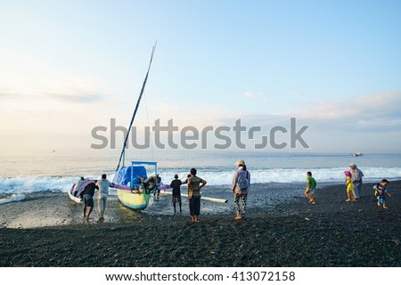 Bali Indonesia Apr 3, 2016 : Morning scene at Kusamba Beach Bali Indonesia. Kusamba Beach is a fisherman village and well known for its traditional salt farming activity. - stock photo