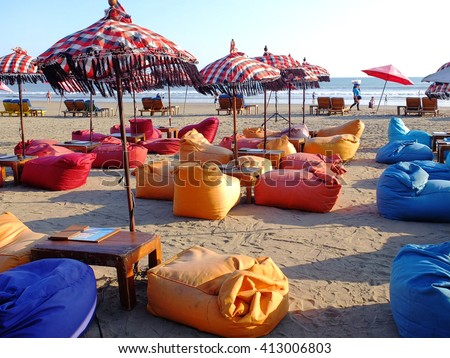 BALI, INDONESIA - APRIL 28, 2016: Bean bags, umbrellas and sun beds on the beach, Seminyak, Bali, Indonesia.