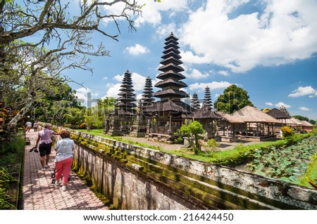 Bali, Indonesia, April 22,2010 : Tourist visiting The Pura Taman Ayun Mengwi temple in Bali, Indonesia.One of Bali's most important temples, Indonesia. - stock photo