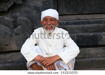 BALI, INDONESIA, APRIL 10: Unidentified Hindu man in Besakih temple on APRIL 10, 2014 in Bali, Indonesia. Besakih temple is one of the most famous hindu temple in Bali island  - stock photo