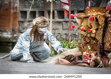 BALI, INDONESIA, DECEMBER, 24,2014 : Barong Dance show, the traditional Balinese performance in Ubud, Bali, Indonesia. This famous play represents an fight between good and bad gods.  - stock photo