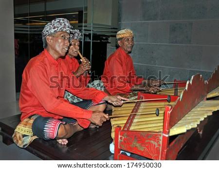 BALI, INDONESIA - FEBRUARY 15, 2012: Gamelan Jegog Trio Performing in Bali, Indonesia. - stock photo