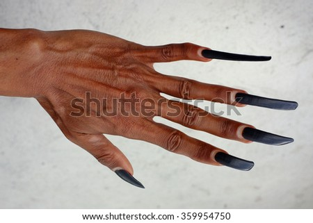 BALI, INDONESIA - January 9, 2016: A traditional Balinese dancer displays his long, manicured, natural, 2 1/2-year-old fingernails on January 9, 2016 in Kintamani, Bali, Indonesia.