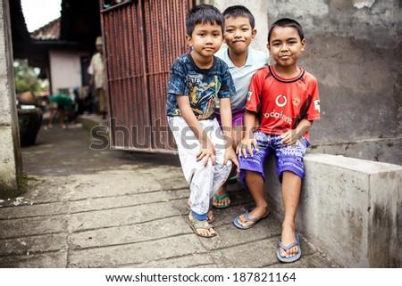 BALI, INDONESIA - JANUARY 16, 2013: Three Balinese boys on January 16, 2013 in Bali, Indonesia - stock photo