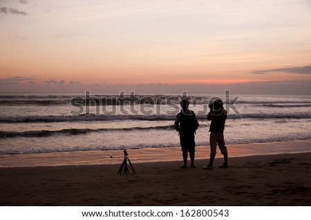 Bali, Indonesia - July 30, 2013: Two photographers taking a picture of the ocean on July 30, 2013, Bali, Indonesia
