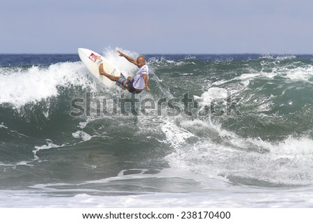 BALI, INDONESIA - JUNE 18: Kelly Slater, an American professional surfer, in action at the Oakley Pro Bali ASP World Championship Tour 2013, June 18, 2013 in BALI, INDONESIA.