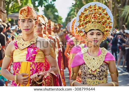 BALI, INDONESIA - JUNE 13: Portrait of Bali people in beautiful Balinese costumes with traditional style face make-up on parade at  Bali arts and culture festival in Denpasar, Bali on 13 June, 2015 - stock photo