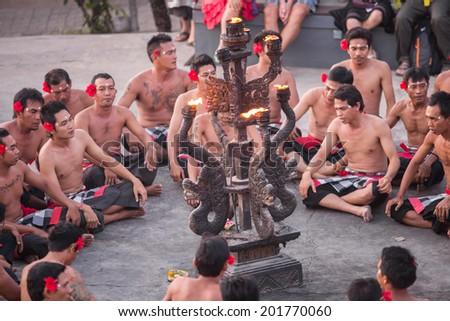 BALI, INDONESIA - June 1: Traditional Balinese Kecak dance at Uluwatu Temple on June 1, 2014, Bali, Indonesia - stock photo