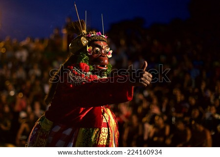 BALI, INDONESIA - JUNE 5: Traditional Balinese Kecak dance at Uluwatu Temple on June 5, 2013, Bali, Indonesia - stock photo