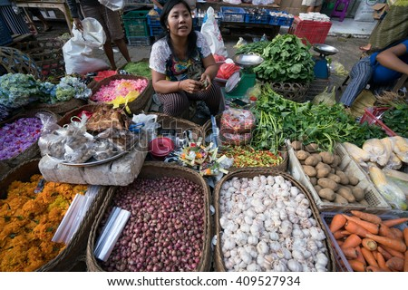 BALI, INDONESIA - MARCH 16, 2016: Commercial activities in the main Ubud market in the morning, shows florist selling flower products. Agricultural produce comes direct from the farmers here in Bali. - stock photo