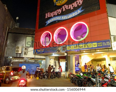 BALI, INDONESIA - MARCH 31: Karaoke bar on March 31, 2013 in Bali, Indonesia. Karaoke bars remain a popular form of entertainment in Asia. - stock photo
