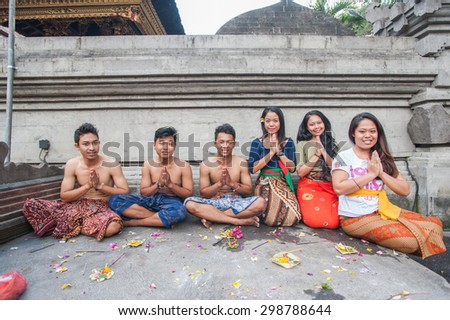 BALI, INDONESIA - NOVEMBER 3RD 2014 : Balinese people pose for the camera at the Holy Spring Tirtha Empul Bali, Indonesia. - stock photo