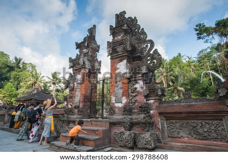 BALI, INDONESIA - NOVEMBER 3RD 2014 : Tourist at Tirtha Empul Bali, Indonesia. - stock photo