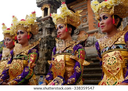 BALI, INDONESIA - OCTOBER 26, 2013: Unidentified Balinese dancers pause during an evening dance performance at the Pura Dalem on October 26, 2013 in Ubud, Bali, Indonesia.