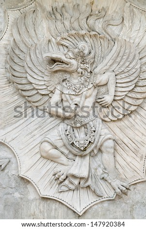 BALI, INDONESIA - SEP 13: Garuda undaunted hindu mythic bird image in GWK culture park on Sep 13 in Bali, Indonesia. Garuda Wisnu Kencana Cultural Park in popular tourist attraction since 2011.