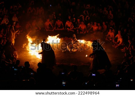 BALI, INDONESIA - SEPTEMBER 19, 2014: Hanuman is set to be burnt alive during a performance of the traditional Balinese Kecak Fire Dance at the Uluwatu Temple in Bali.  - stock photo