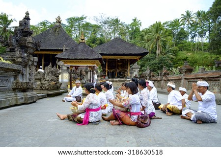 Bali, Indonesia - September 19, 2014 : Local Balinese praying at holy spring water temple Pura Tirtha Empul during the religious ceremony  in Tampak Siring, Bali, Indonesia.  - stock photo