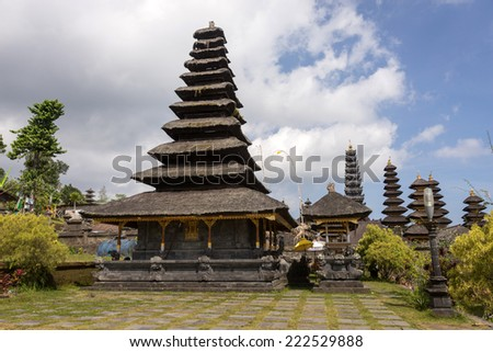 BALI, INDONESIA - SEPTEMBER 20, 2014: Tourists and devotees visit the Besakih Temple Complex, the largest and most important Hindu temple in Bali. Many significant religious events are held here. - stock photo