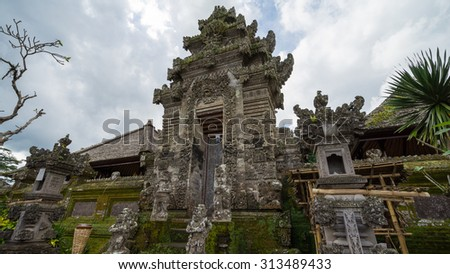 BALI, INDONESIA - 19TH JUNE 2015; Traditional Balinese buildings seek to be in harmony with the environment. The houses are built almost entirely from organic materials such as stones and hard wood